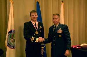Lieutenant Commander Timothy David Ladowicz, US Navy- Operations Branch Chief, Missile Defense Division, US Northern Command (left)