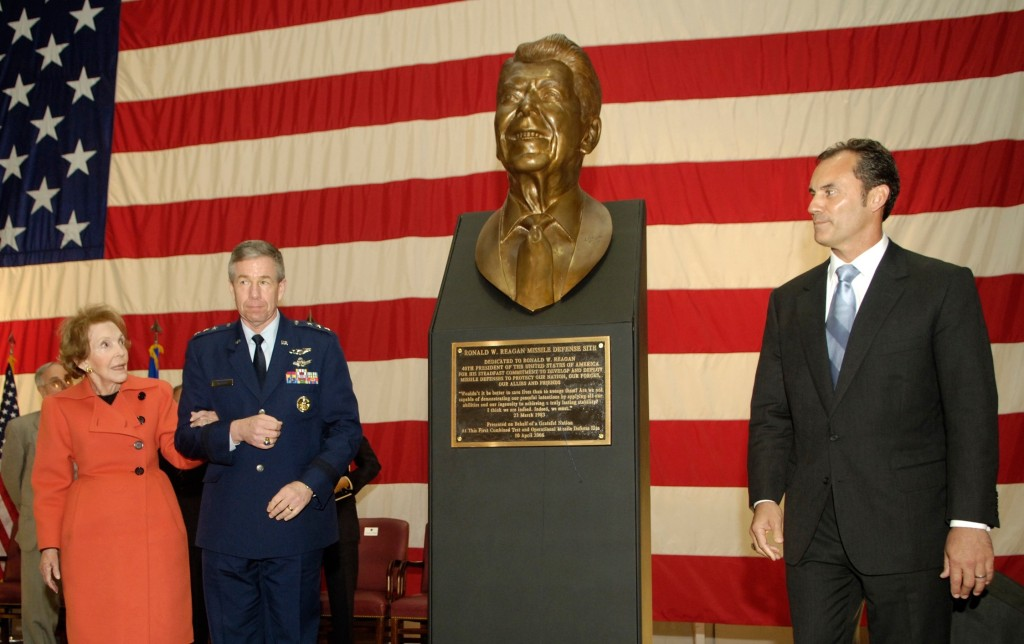 Former First Lady Nancy Reagan, escorted by Lt. Gen. Henry A. Obering III, Director Defense Missile Agency helps Mr. Riki Ellison, Founder and President, Missile Defense Advocacy Alliance, unveil a bust of President Ronald Reagan the dedication ceremony of the Ronald W. Reagan Missile Defense Site